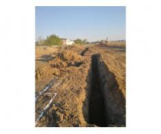 Inchiriez buldo-excavator cu cupa multifunctionala